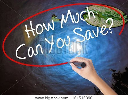 Woman Hand Writing How Much Can You Save? With Marker Over Transparent Board