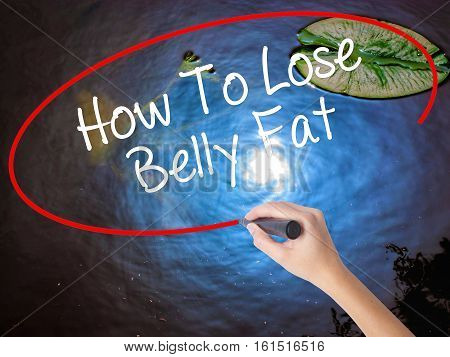 Woman Hand Writing How To Lose Belly Fat With Marker Over Transparent Board