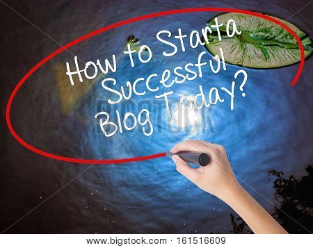 Woman Hand Writing How To Start A Successful Blog Today? With Marker Over Transparent Board