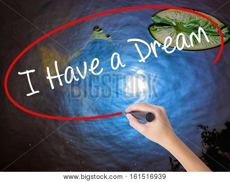 Woman Hand Writing I Have A Dream With Marker Over Transparent Board