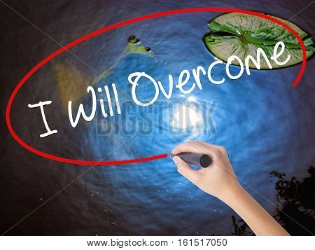 Woman Hand Writing I Will Overcome With Marker Over Transparent Board