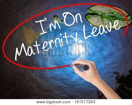 Woman Hand Writing  I'm On Maternity Leave With Marker Over Transparent Board