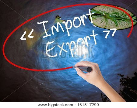 Woman Hand Writing Import - Export With Marker Over Transparent Board.
