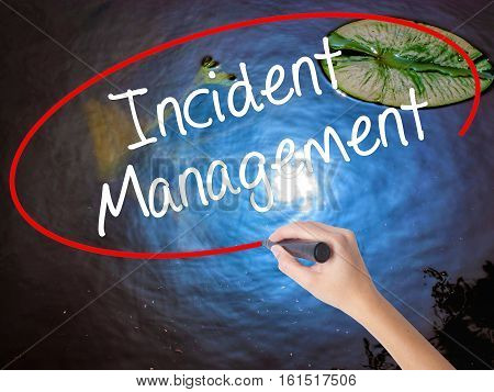 Woman Hand Writing Incident Management With Marker Over Transparent Board