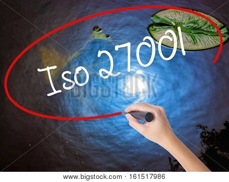 Woman Hand Writing Iso 27001  With Marker Over Transparent Board