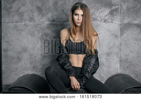 Sports beautiful girl, Fashion sport, young girl with a slender body.