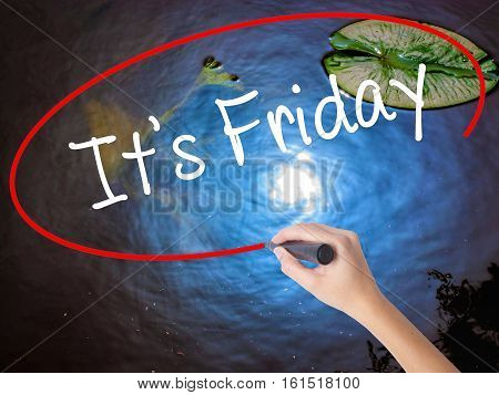 Woman Hand Writing It's Friday With Marker Over Transparent Board