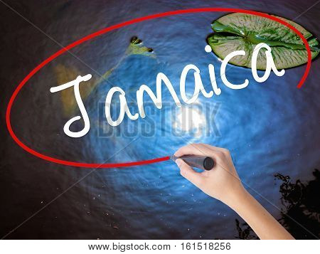 Woman Hand Writing Jamaica  With Marker Over Transparent Board