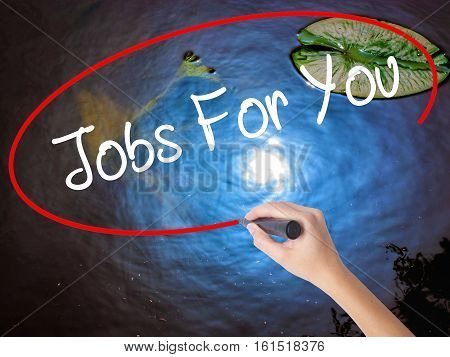 Woman Hand Writing Jobs For You With Marker Over Transparent Board