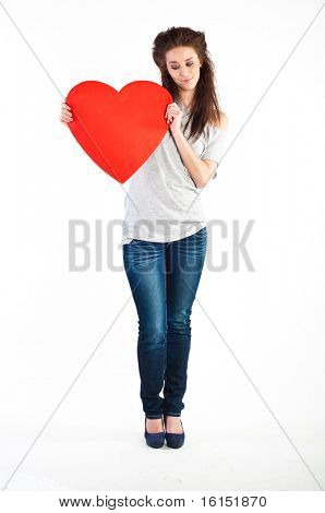 young girl holding red heart