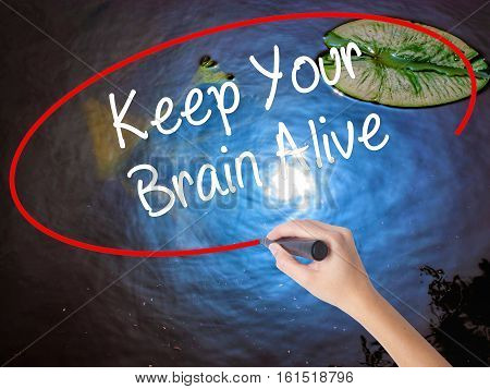 Woman Hand Writing Keep Your Brain Alive With Marker Over Transparent Board
