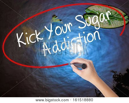 Woman Hand Writing Kick Your Sugar Addiction With Marker Over Transparent Board