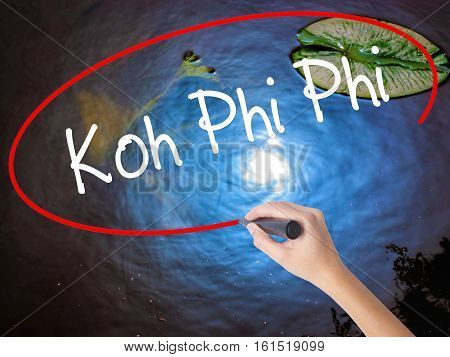 Woman Hand Writing Koh Phi Phi With Marker Over Transparent Board.