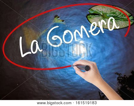 Woman Hand Writing La Gomera With Marker Over Transparent Board.