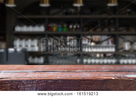 Glass On Counter Bar In Restaurant Interior Blur Background With Selected Focus Empty Wood Table For