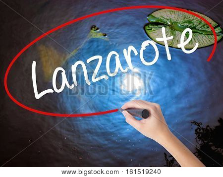 Woman Hand Writing Lanzarote With Marker Over Transparent Board.