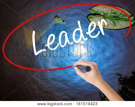 Woman Hand Writing Leader With Marker Over Transparent Board