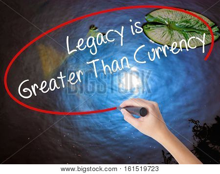 Woman Hand Writing Legacy Is Greater Than Currency With Marker Over Transparent Board