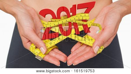 3D Close-up mid section of a woman measuring waist against new year with tape measure