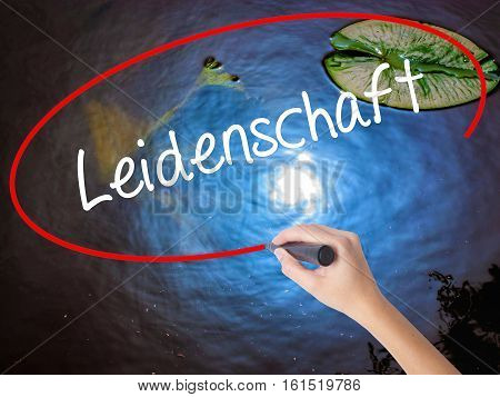 Woman Hand Writing Leidenschaft (passion In German)  With Marker Over Transparent Board