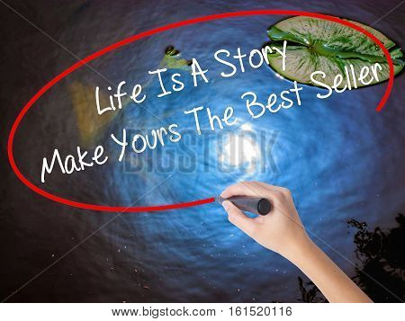 Woman Hand Writing Life Is A Story Make Yours The Best Seller With Marker Over Transparent Board