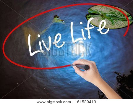 Woman Hand Writing Live Life With Marker Over Transparent Board
