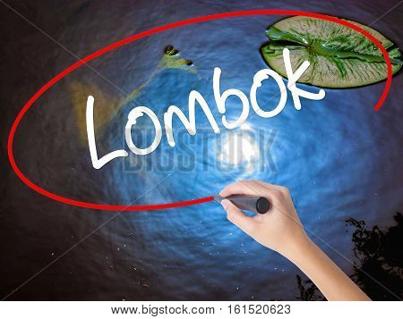 Woman Hand Writing Lombok  With Marker Over Transparent Board