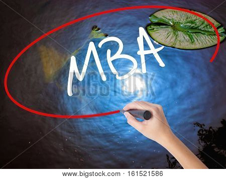 Woman Hand Writing Mba With Marker Over Transparent Board