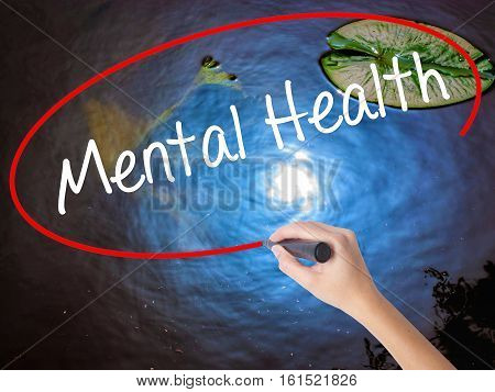 Woman Hand Writing Mental Health With Marker Over Transparent Board