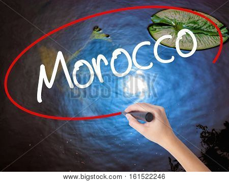 Woman Hand Writing Morocco  With Marker Over Transparent Board