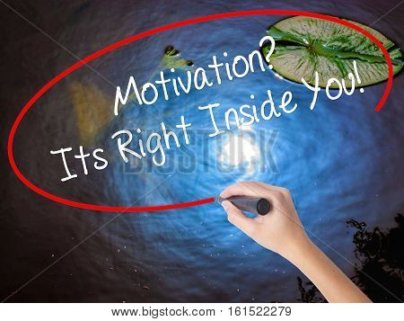 Woman Hand Writing Motivation? Its Right Inside You!  With Marker Over Transparent Board