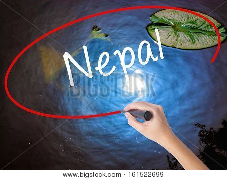 Woman Hand Writing Nepal  With Marker Over Transparent Board