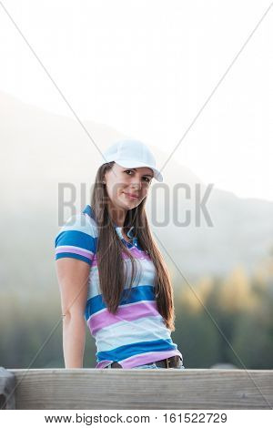 Portrait of a young woman in hat on a holday in mountains