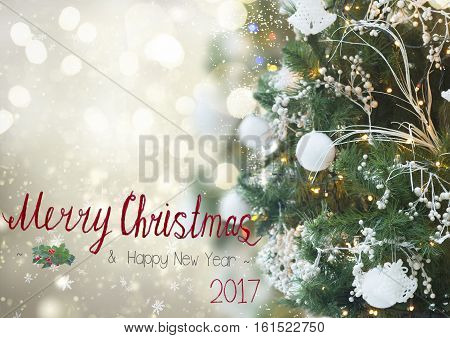 christmas tree with holiday white decorations and lights on silver background and merrychristmas greetings