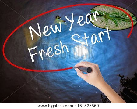 Woman Hand Writing New Year Fresh Start With Marker Over Transparent Board