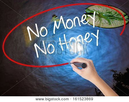 Woman Hand Writing No Money No Honey With Marker Over Transparent Board.