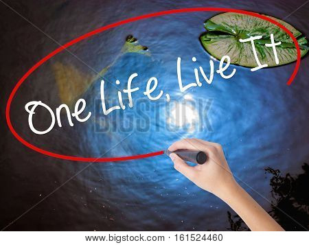 Woman Hand Writing One Life Live It With Marker Over Transparent Board.