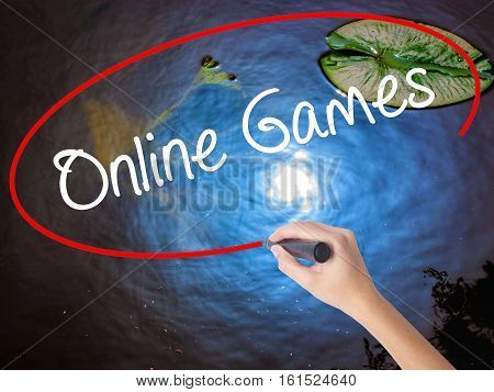 Woman Hand Writing Online Games With Marker Over Transparent Board
