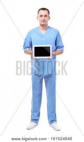 Practitioner in blue uniform holding tablet on white background