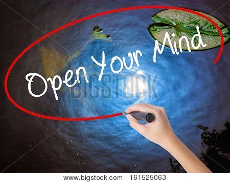 Woman Hand Writing Open Your Mind With Marker Over Transparent Board
