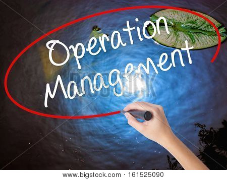 Woman Hand Writing Operation Management With Marker Over Transparent Board.