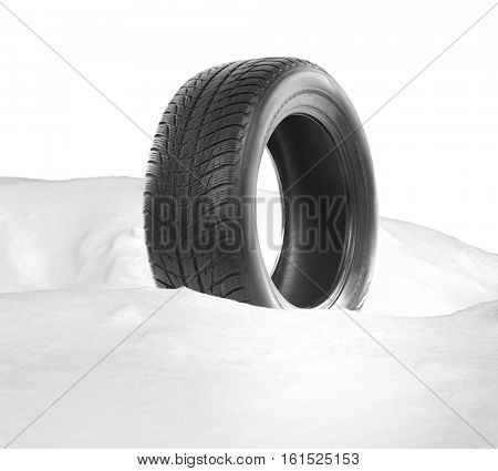 Car tire in snowdrift on white background. Winter tires concept.