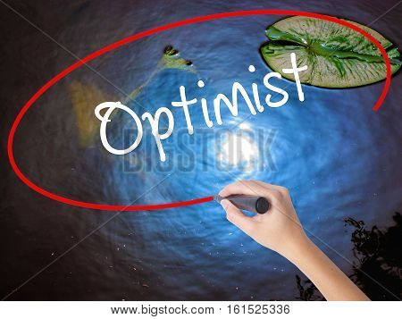 Woman Hand Writing Optimist  With Marker Over Transparent Board