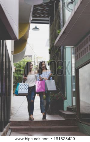 Happy Asian Woman With Colorful Shopping Bags At Department Store Shopping Mall, Blur Background