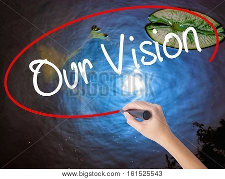 Woman Hand Writing Our Vision With Marker Over Transparent Board