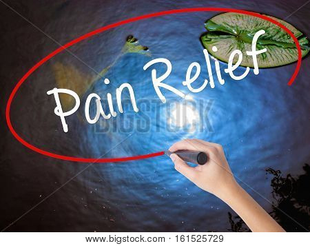 Woman Hand Writing Pain Relief With Marker Over Transparent Board