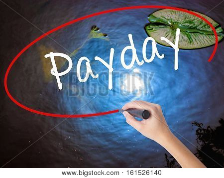 Woman Hand Writing Payday With Marker Over Transparent Board