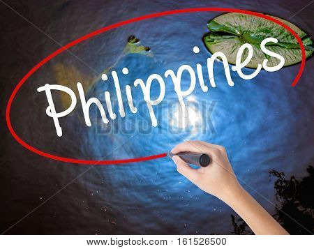 Woman Hand Writing Philippines With Marker Over Transparent Board