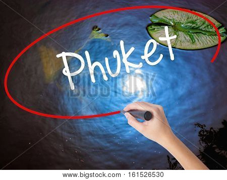 Woman Hand Writing Phuket With Marker Over Transparent Board