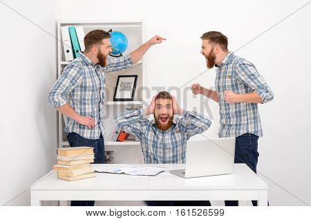 Group of hardworking employee clones having an argument in office